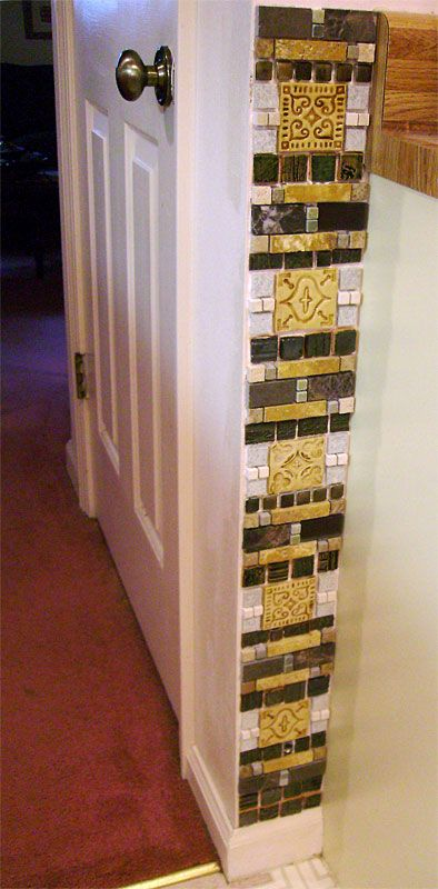 Strip of tile by my pantry door. The large ochre colored tiles were made by me and so were some of the other smaller ones. Other tiles were either salvaged or purchased. Grout will be a dark terra cotta color.