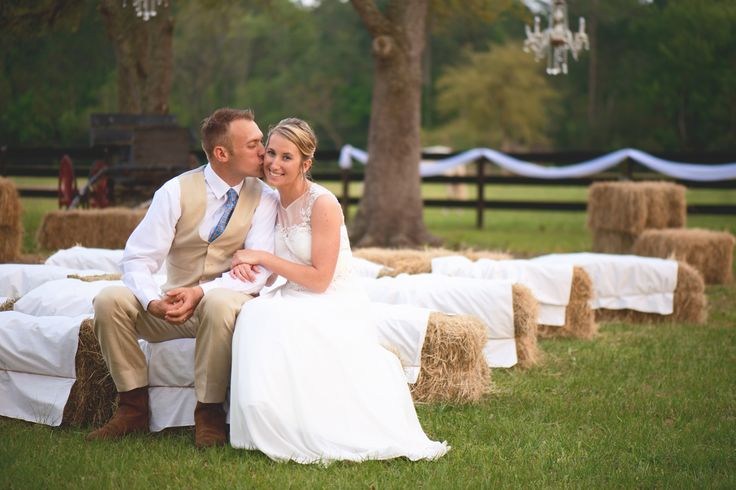 a kiss from my groom on our haybale seating