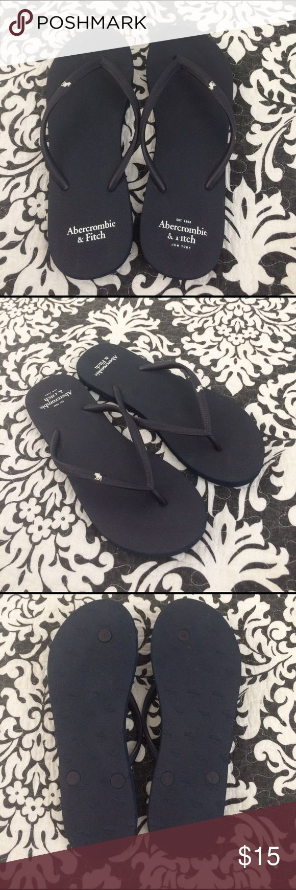 A&F Navy Flip Flops Comfortable flip flops with a solid coloring throughout, flexible straps, logo accent. Worn once in perfect condition. Abercrombie & Fitch Shoes Sandals