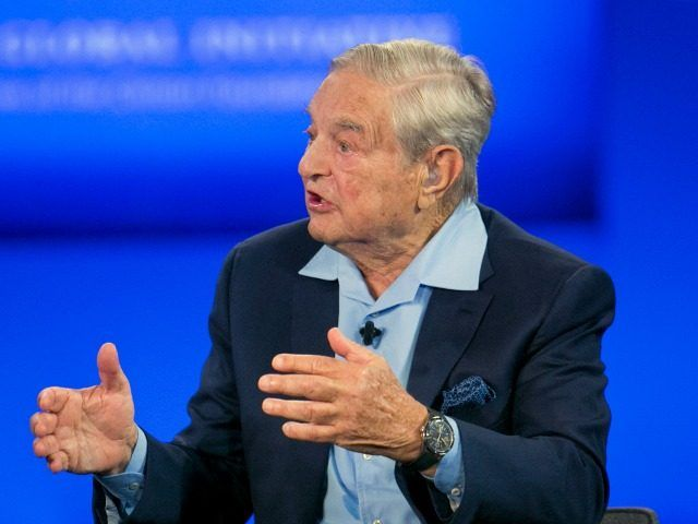 George Soros, Chairman of Soros Fund Management, talks during a television interview for CNN, Sunday, Sept. 27, 2015 at the Clinton Global Initiative in New York. (AP Photo/Mark Lennihan)