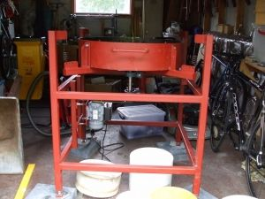 Vibratory Tumbler - Homemade vibratory tumbler driven by a 1/4 HP motor. Fabricated from steel, pillow block bearings, pulleys, and hardware.