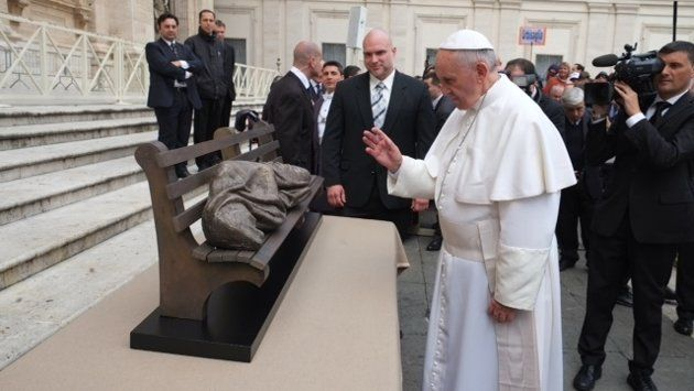 "Pope Francis with ""Homeless Jesus"" (CTV/Timothy P. Schmalz)"