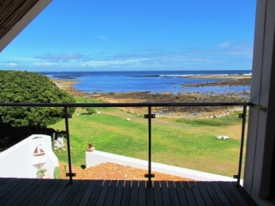 """A rare opportunity to acquire this ocean front property prominently positioned in the """"old Kom"""" area on 688sqm of prime land. Features separate dining room, enormous lounge looking out towards the ocean, with a guest bedroom and bathroom downstairs as well as a large study/fifth bedroom. Upstairs room and superb ocean and mountain views, two additional bedrooms with built in cupboards and a family bathroom. Step outside onto the deck to absord the breathtaking surroundings."""