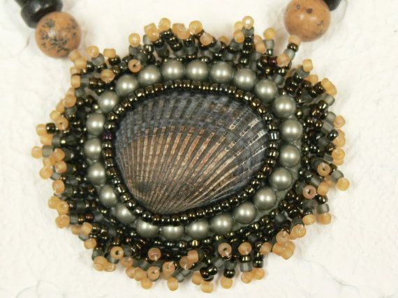 Sea shell necklace with seaweed style beaded bezel by Evesbeads, $180.00