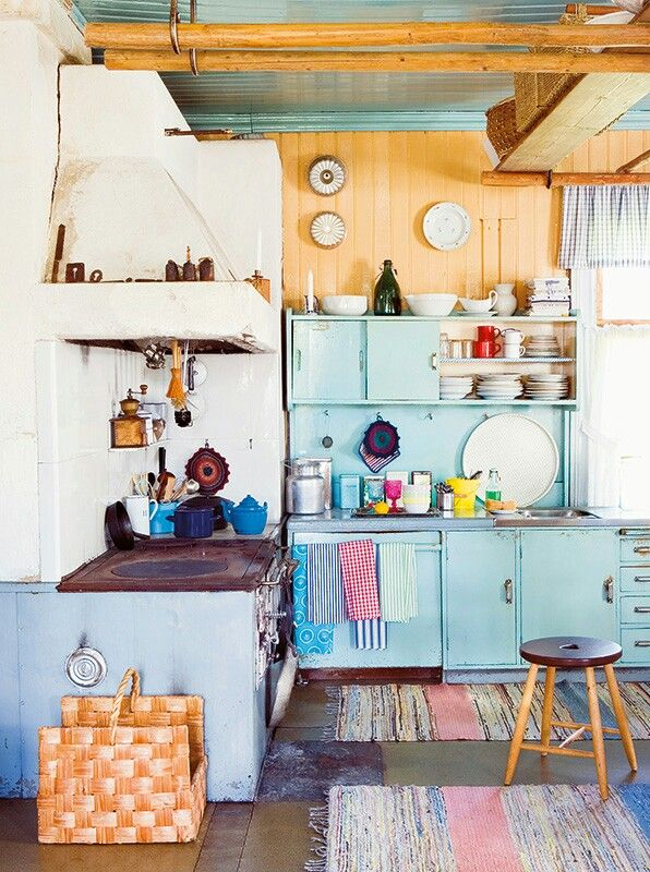 Love the colors - the robin's egg blue makes me happy. The rag rugs are cozy - reminds me of my grandma's house! #interiordesign #kitchen