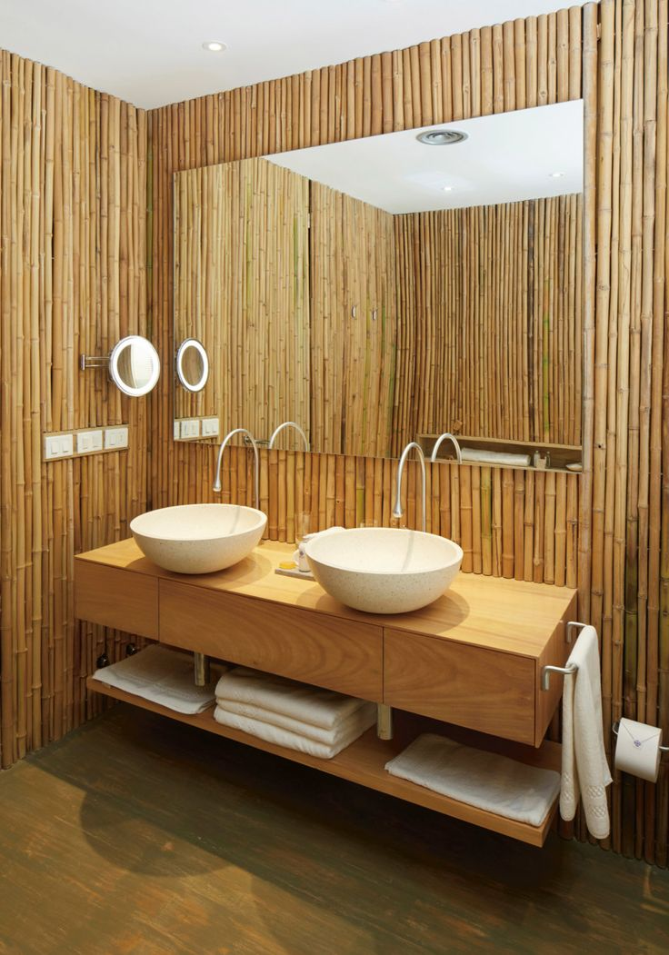 When you shift from thinking about a bathroom as simply a functional space to one that's about relaxing and recharging, your whole perspective on its design changes. Creating a space that feels both calming and beautiful becomes the priority. In this bathroom at the Bahia Vik in Uruguay, walls are covered in bamboo instead of the more expected tile for a bathroom that feels like a tropical retreat. By only using one natural material, the overall effect is calming.