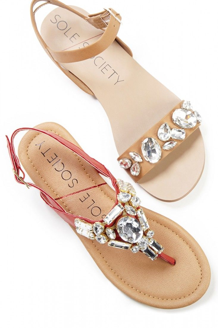 Flat sandals bejeweled with sparkling crystal stones. A spring/summer essential.