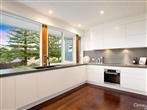 Kitchen concertina window / stone benchtop