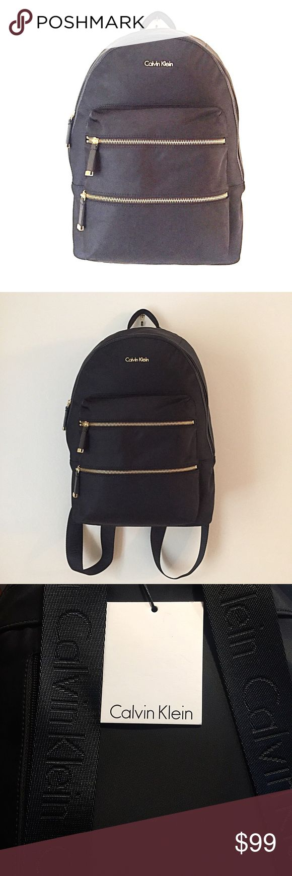 """🎁 GIFT IDEA 🎁 Calvin Klein Black w/Gold Backpack BRAND NEW WITH TAGS  - Black nylon with gold tone zipper and logo accents  - Top handle  - Dual adjustable shoulder straps with Calvin Klein logo  - Zip around top closure  - Exterior features two front zip pocket and one back zip pocket  - Interior features 1 wall zip and 2 wall slip pocket  - Approx. 16"""" H x 11"""" W x 5"""" D  - Approx. 1.5"""" handle drop, 12-18"""" strap drop  - Imported Calvin Klein Bags Backpacks"""