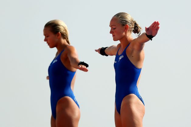 Tonia Couch and Sarah Barrow of Great Britain compete in the Women's 10m Platform Synchronized Diving preliminary round on day three of the 15th FINA World Championships at Piscina Municipal de Montjuic on July 22, 2013 in Barcelona. Photo: Clive Rose, Getty Images / 2013 Getty Images