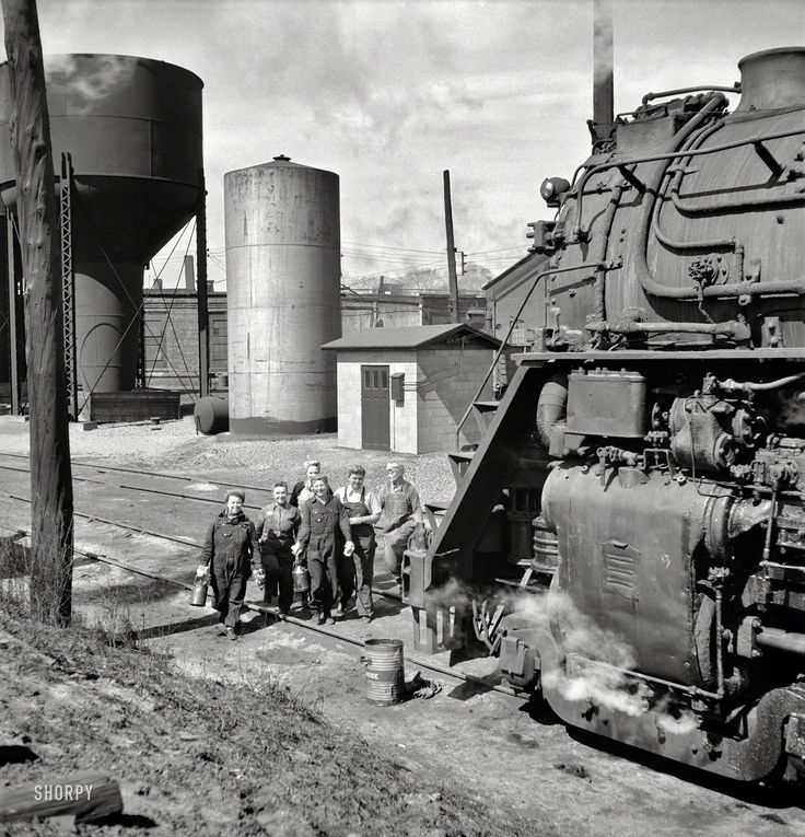 Women wipers in front of huge train [1900  1977] Chicago & North Western…