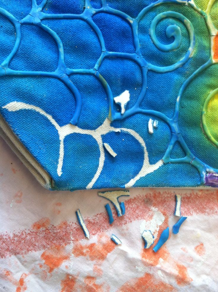 Flour Resist Batik: mix a flour/water 'paste' and apply to fabric with a piping bag, in whatever pattern you want! Let dry overnight. Use thinned faric paint OR thin acrylic paint (we used regular craft paint), mix with fabric medium per manuf directions, and brush on. Layer colors in some places to mix ON the fabric. They will blend nicely if thinned out. Let dry. Then peel off dried 'paste' to reveal the resist pattern beneath! Viola! Back Gate Studio/Boise, ID