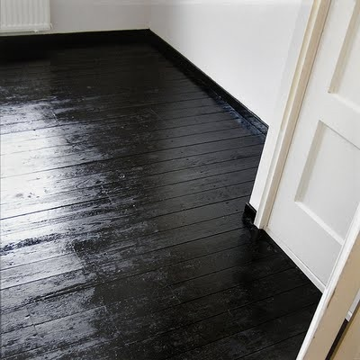 black wood floor  tiildown.tumblr.com. Could sit above tile. Could be gloss or matte.