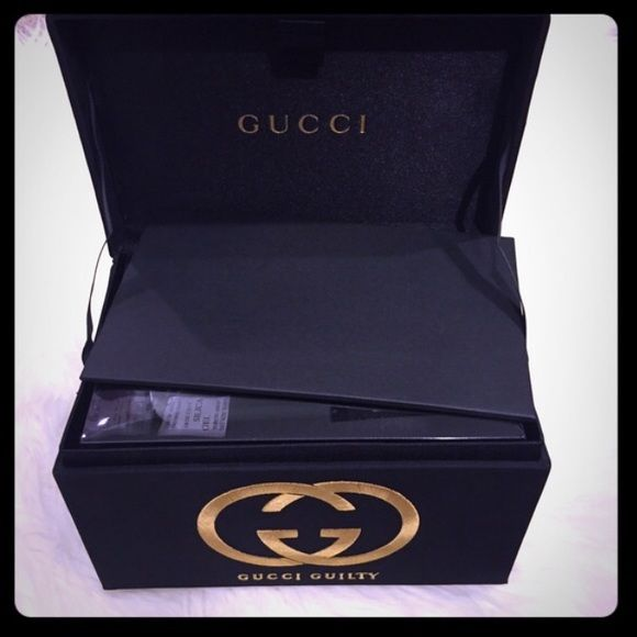Gucci Guilty Box Authentic, elegant Gucci Guilty black and gold Box. Brand New, never used. 8in x 5in. You can use it as gift box, store makeup! As a jewelry box, store sunglasses, pictures, accessories, and more. In mint condition. Feels like silk material. Black and gold, no stains or dents. I am comparing the size next to my size 6.5 stiletto to give you an idea of the width. Opened from its Original wrapping package. Please see my other listing for one that is still in its original…