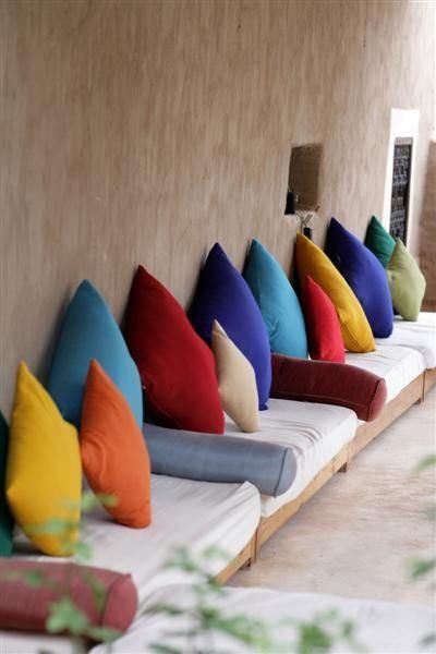 | P | For the patio - colourful banquette cushions and bolsters Moroccan style