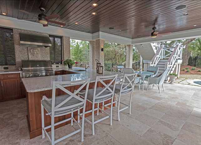 Outdoor Kitchen. The homeowners don't have to go far to get to their new outdoor, in-ground pool. They can float in the sun or enjoy the shade provided by the second story of their home, and if they get hungry, they can head straight to their tiled outdoor kitchen. #Outdoor #Kitchen