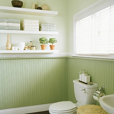 A clean look for a traditional bathroom update. Love that they painted the lower half of the walls with that soft green paint....