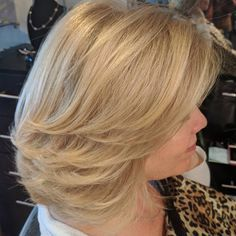 Medium Strawberry Blonde Hairstyle With Swoopy Layers