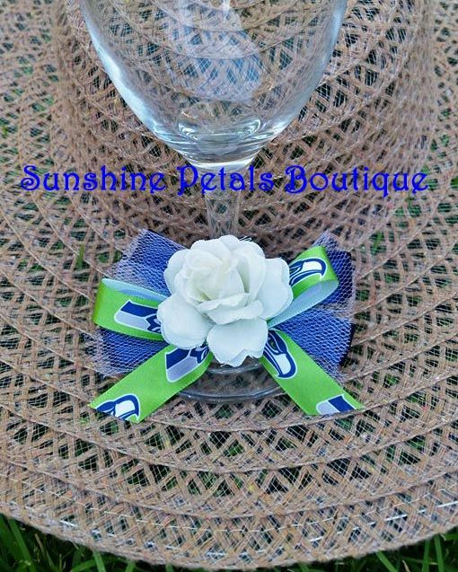 NFL toasting glass decorations.  Sunshine Petals Boutique *Artificial Flowers * Event Essentials * Home Decor * Creative Inspirations from the Heart! Custom and personalized orders welcome!  Owner: Rhonda Newton - 208.262.6148.  Ravens, Bills, Bengals, Browns, Broncos, Texans, Colts, Jaguars, Chiefs, Dolphins, Patriots, Jets, Raiders, Steelers, Chargers, Titans, Cardinals, Falcons, Panthers, Bears, Cowboys, Lions, Packers, Vikings, Saints,Giants, Eagles,Rams,49ers, Seahawks…