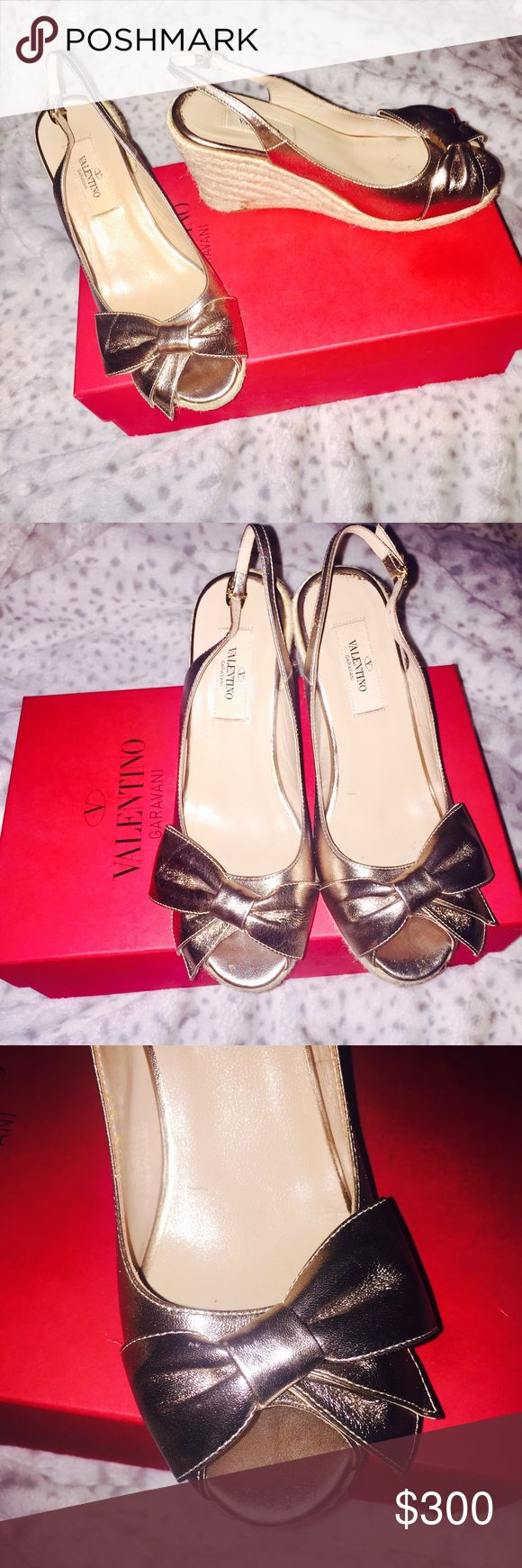 Authentic Valentino wedges I've only worn these twice. Time for a new home. These are Authentic purchased from Saks Fifth Avenue. I have the receipt if you want it. Color is a soft gold. No lowball offers please. I'd rather keep them. Valentino Shoes Wedges