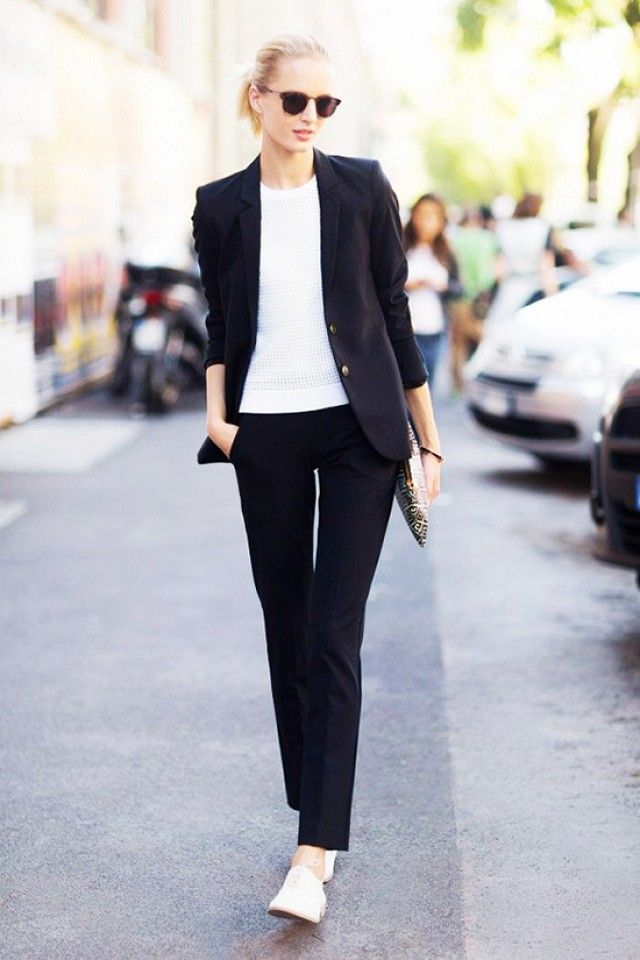 Work attire. More casual look with a black suit and flats or loafers. Simple, professional and chic.