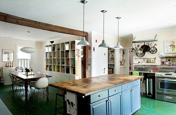 Kitchen with rustic work surface, painted cabinets and industrial lights. Plus, modern chairs at rustic table