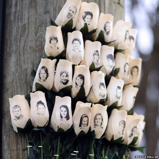 White roses with the faces of victims of the Sandy Hook Elementary School shooting are displayed one month after the massacre in Newtown, Connecticut, which left 26 dead, including 20 children.