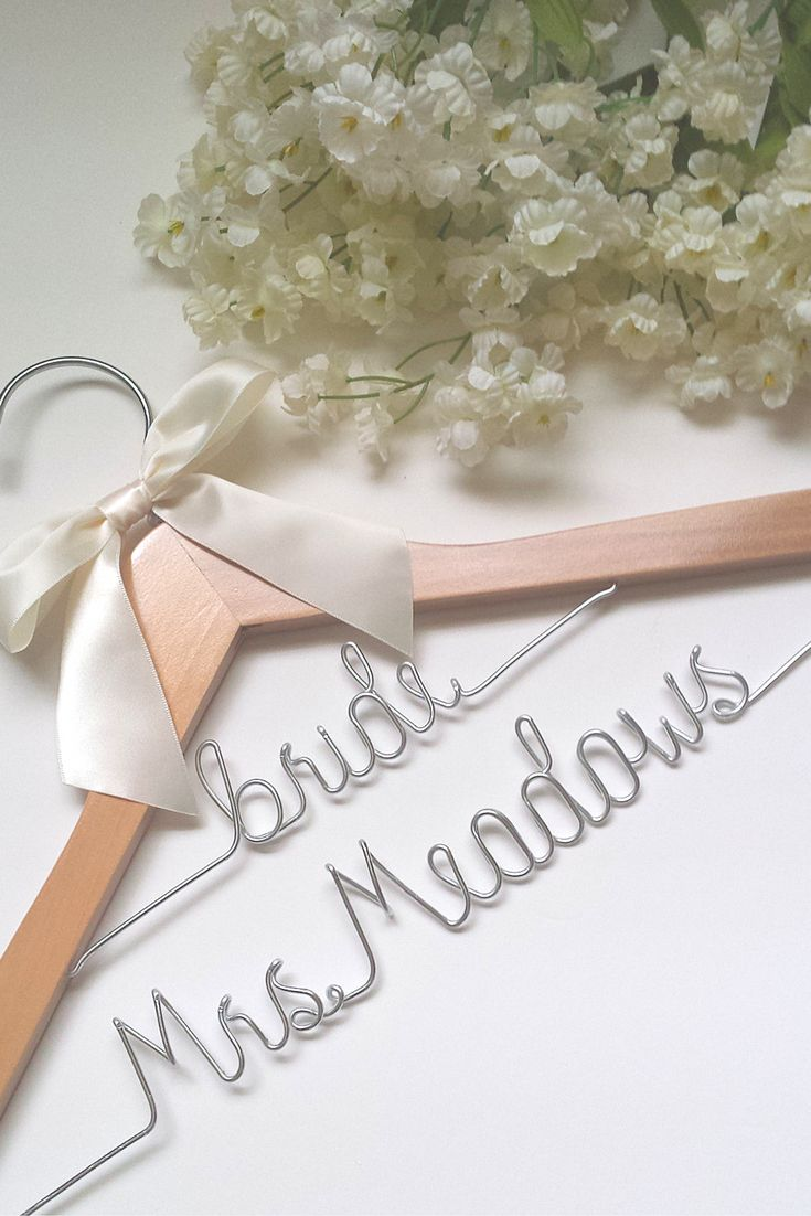 """A unique custom bridal hanger for the unique bride! We will put the word """"bride"""" on the top tier, and the bride's future name on the bottom for you! *ALL orders now ship for free until January! *If yo"""