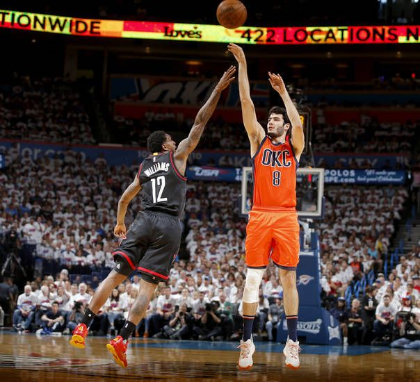 Oklahoma City's Alex Abrines (8) shoots over Houston's Lou Williams (12) during Game 4 in the first round of the NBA basketball playoffs between the Oklahoma City Thunder and the Houston Rockets at Chesapeake Energy Arena in Oklahoma City, Sunday, April 23, 2017. Photo by Bryan Terry, The Oklahoman