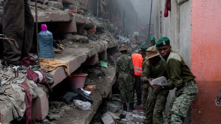 Kenyan National Youth Service personnel remove stones with hands at the site of a building collapse in Nairobi, Kenya, Saturday, April 30, 2016