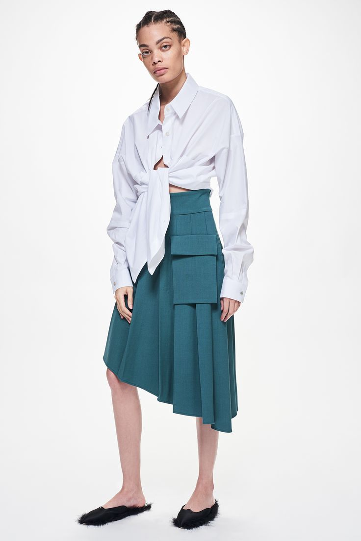 Ji Oh White Poplin Oversized Button Down Perry Shirt And Green Wool Pleated Asymmetrical Hem Skirt With Side Cargo Pocket
