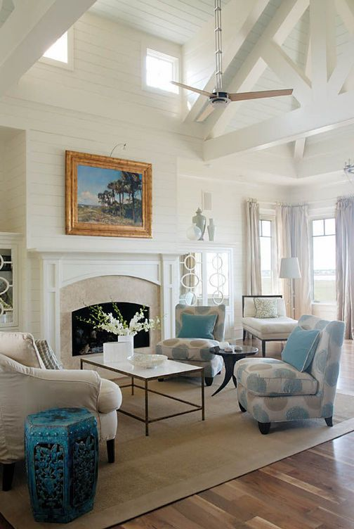 those ceilings and that millwork in this pretty living room.