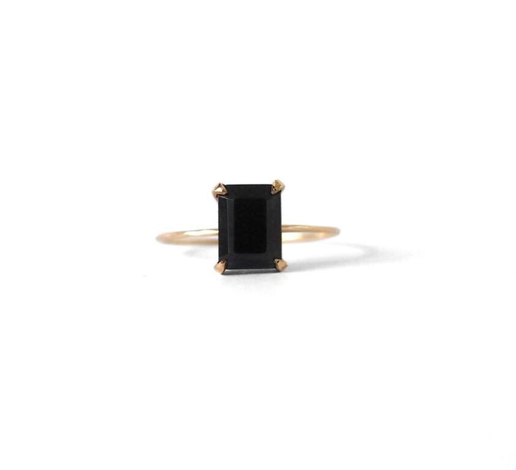 An elegant emerald cut black spinel set in a Sterling Silver, 9ct Yellow or Rose Gold band. Glossy and beautifully contrasted, this piece is a classic addition