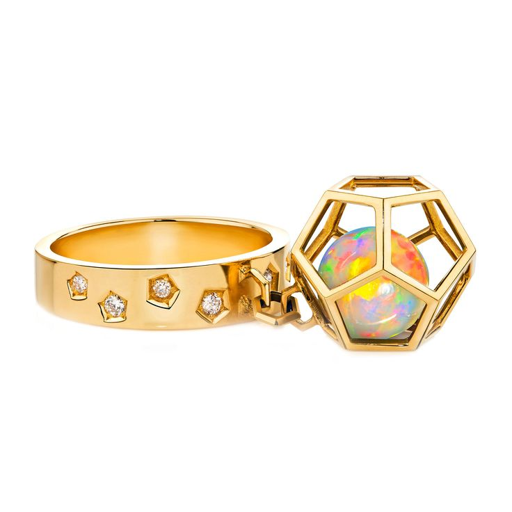 Ornella Iannuzzi Rock It! Cage ring. Gold, diamonds and Opal orb in cage.