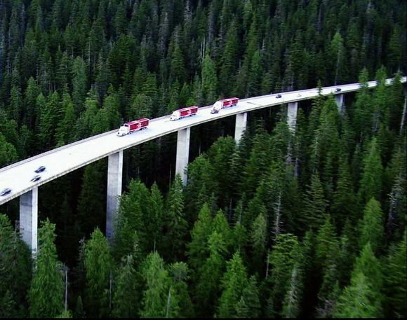 Incredible Drive Above the Trees - in WASHINGTON state, about two miles west of the summit of Snoqualmie Pass on Interstate 90 through the Cascade Mountains; it is a 20-span, 3,630 feet long viaduct across a steep, forested slope, a deep ravine, and an avalanche path