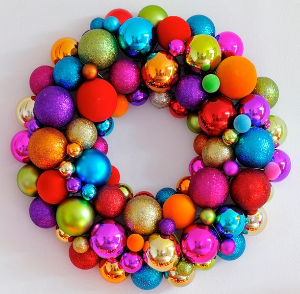 10 Simple DIY Holiday Wreaths #Christmas #craft Hot glue bright and bold ornaments to a wreath frame for a flashy, contemporary twist.