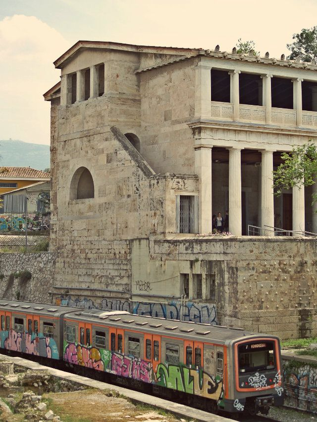 The green line train passes right in front of the Stoa of Attalos. (Walking Athens - Route 04 / Plaka)
