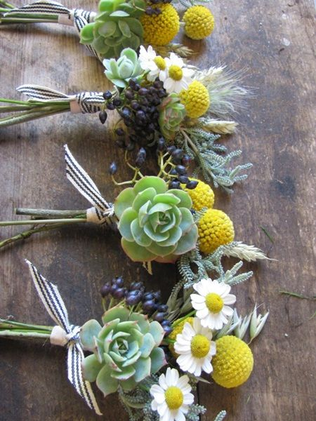 Natural Wedding Co: The Blue Carrot  Little bouquets on tables or around of succulents and violet/blue flowers