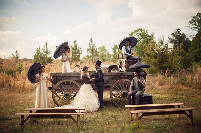 An old wood wagon makes for a unique backdrop for your ceremony - perfect for rustic weddings!