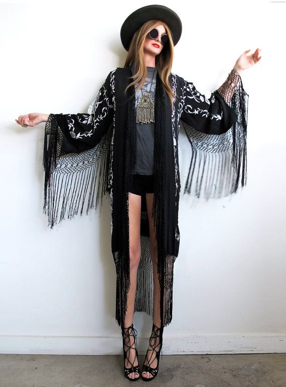 Stevie Nicks inspired...total bohemian babe goodness! Gorgeous doesn't even begin to describe this kimono...with tons of hand embroidery throughout and flowy silk fishnet fringe! Made using a Spanish shawl with no side seams. This stunning kimono can be styled so many different ways, with an effortless vintage vibe sure to be a piece to be treasured for many many years!Recommended for up to a sz 12 but please read measurements.Measurements taken while garment is laid flat:Bu...