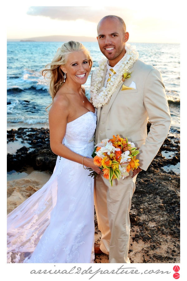 Bride & Groom photo along the beach in Maui, Hawaii.  Destination Wedding, Tropical Wedding, Tropical Colors.  Photo by www.arrival2departure.com