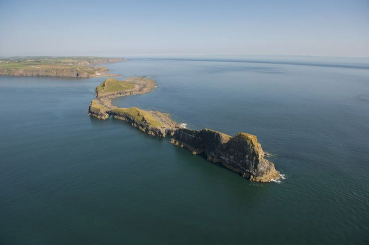 This is Worms Head, off the shore of Rhossili Bay on the Gower Peninsula in Wales. (UK) The Gower Peninsula is an Area of Outstanding Beauty