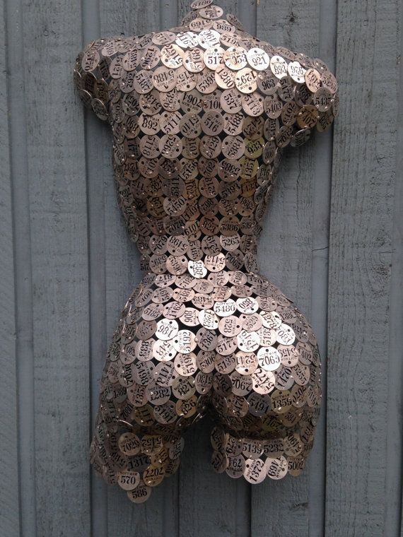 Abstract Metal Wall Art sculpture by Holly Lentz  Could you do this same idea by glueing pennies or washers over a form? Possible use for that flea market chicken I have