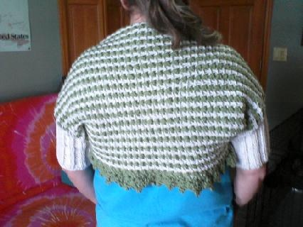 My mom used to knit this shrug for friends.   I  found the pattern and added a crochet border :)