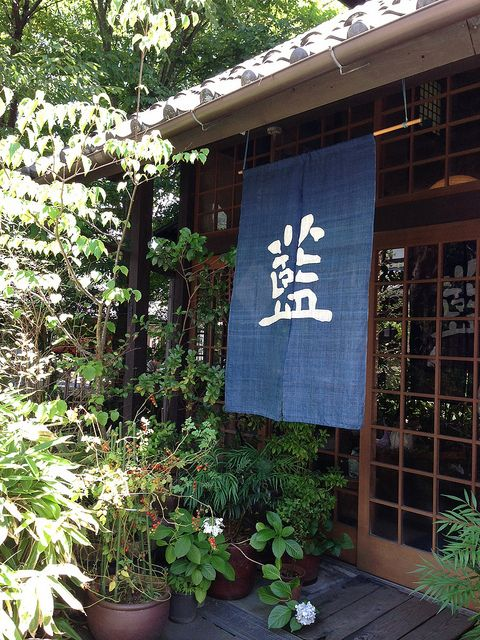 Noren Japanese fabric dividers, hung between rooms, on walls, in doorways, or in windows.