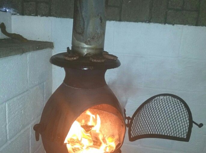 Cooking Burgers outside  on a cast Chimnea.