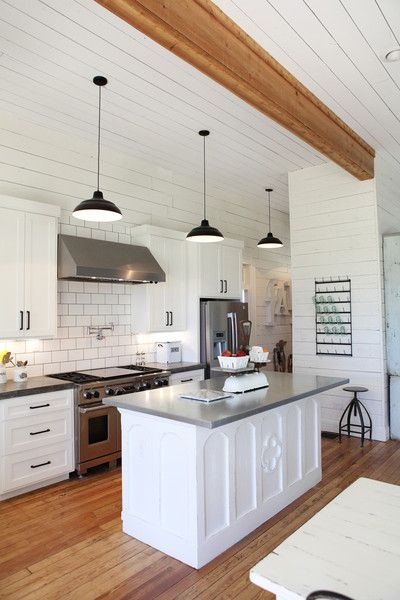 Love this open floor plan kitchen with exposed wood beams, white cabinets, and white subway tiles with gray grout -- modern and clean, but totally classic style ideas here!