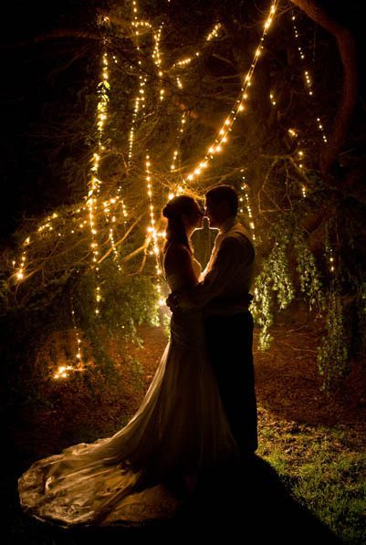 Wedding photo idea - silhouette against lights. Reminds me of Lord of the Rings, with Arwen and Aragorn