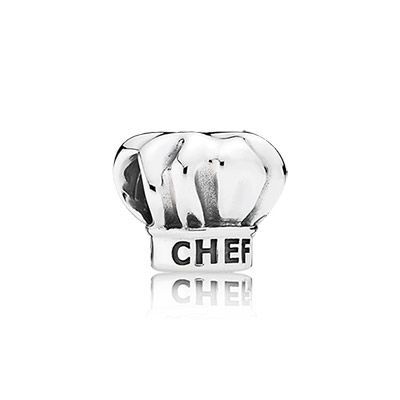 The chef's hat is an ancient and traditional part of a chef's uniform and a symbol of the popularity of cooking and healthy living. With a sweet engraving showcasing a dedication to cooking, this whimsical sterling silver charm is a great choice for professional chefs as well as aspiring cooks and food lovers. #PANDORA #PANDORAcharm