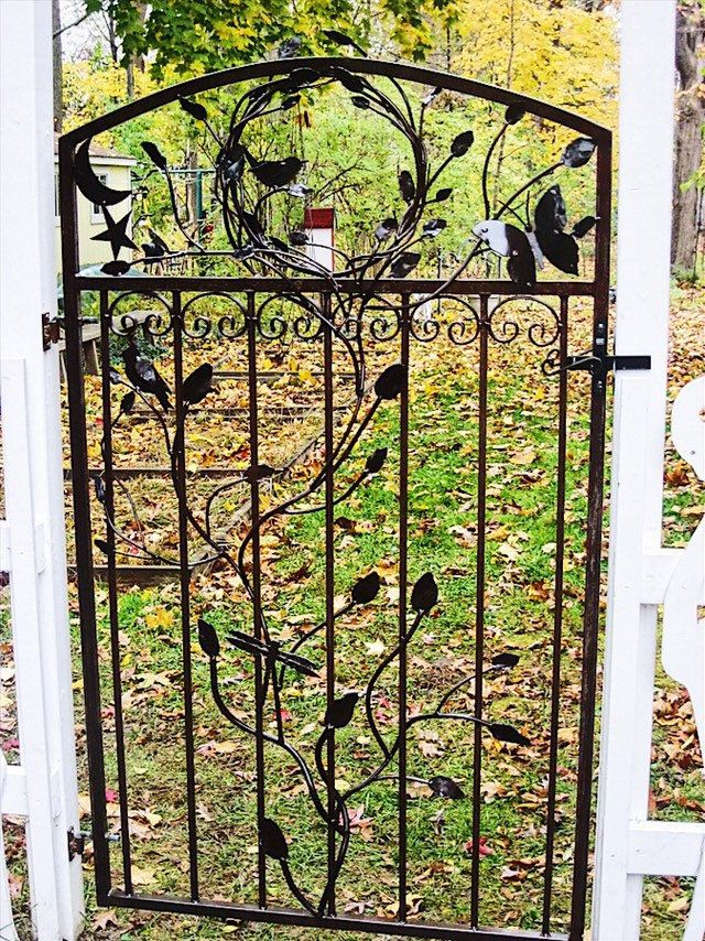 Wrought Iron Gate Featuring Scrolls And Knuckles Iron Gate